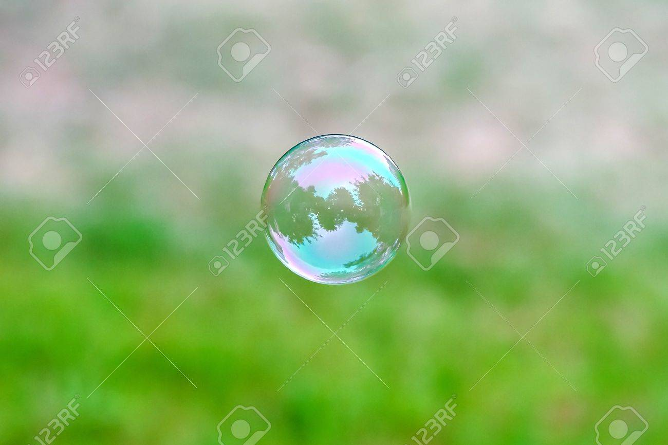 Soap bubble flying. City reflected in. Park. - 20516306