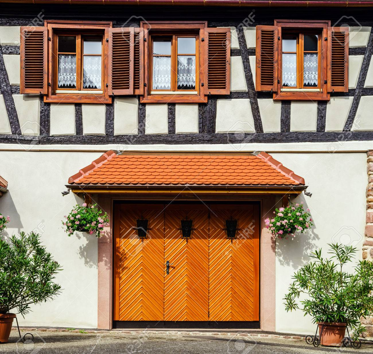 Renovated wooden garage doors in old house, Alsace, France Stock Photo - 29152154