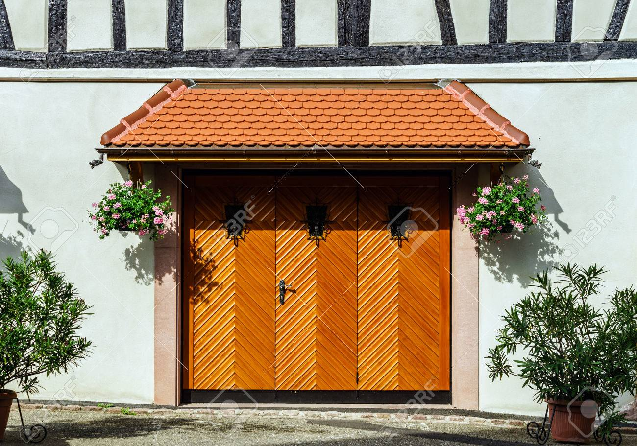 Renovated Wooden Garage Doors In Old House Alsace France Stock