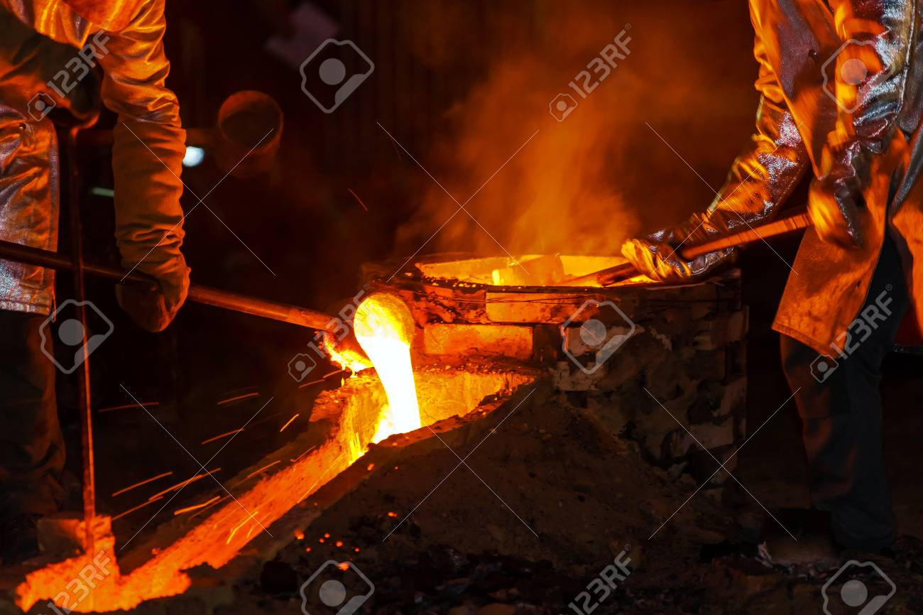 Classic technology of bell producing with melting steel in the ground. France. - 42583820