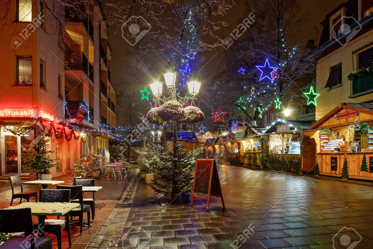 Strasbourg France Christmas Time.Snow Covered Street Cafe Tables On Winter Street Strasbourg