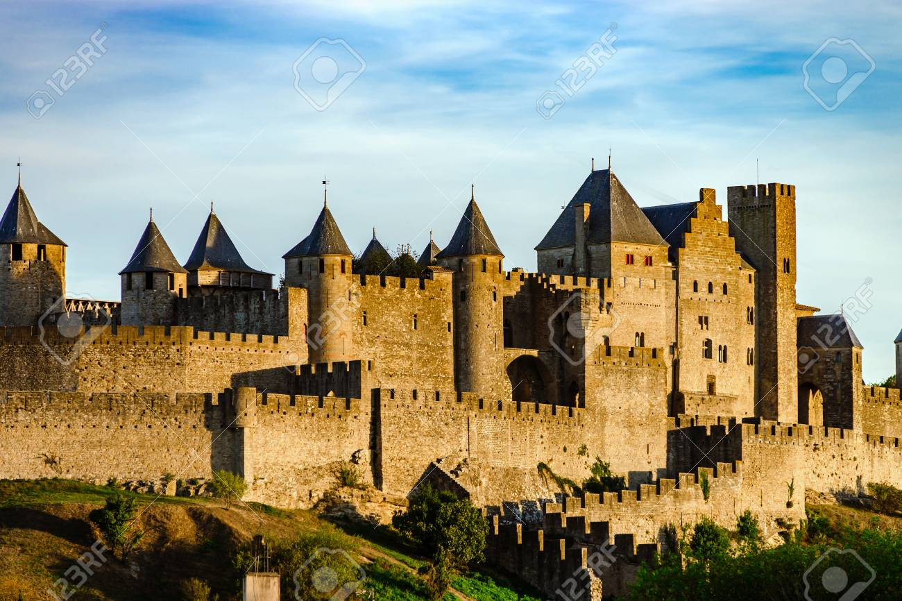Carcassonne medieval fortress sunset view, warm light, France - 93875310