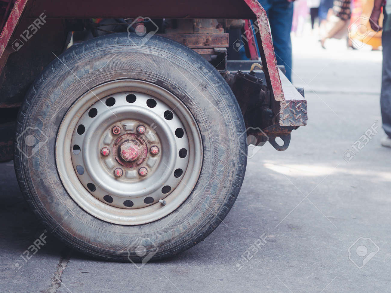 Close-up photo of a car wheel of E-taen Thai tractor. Space for text. - 165074422