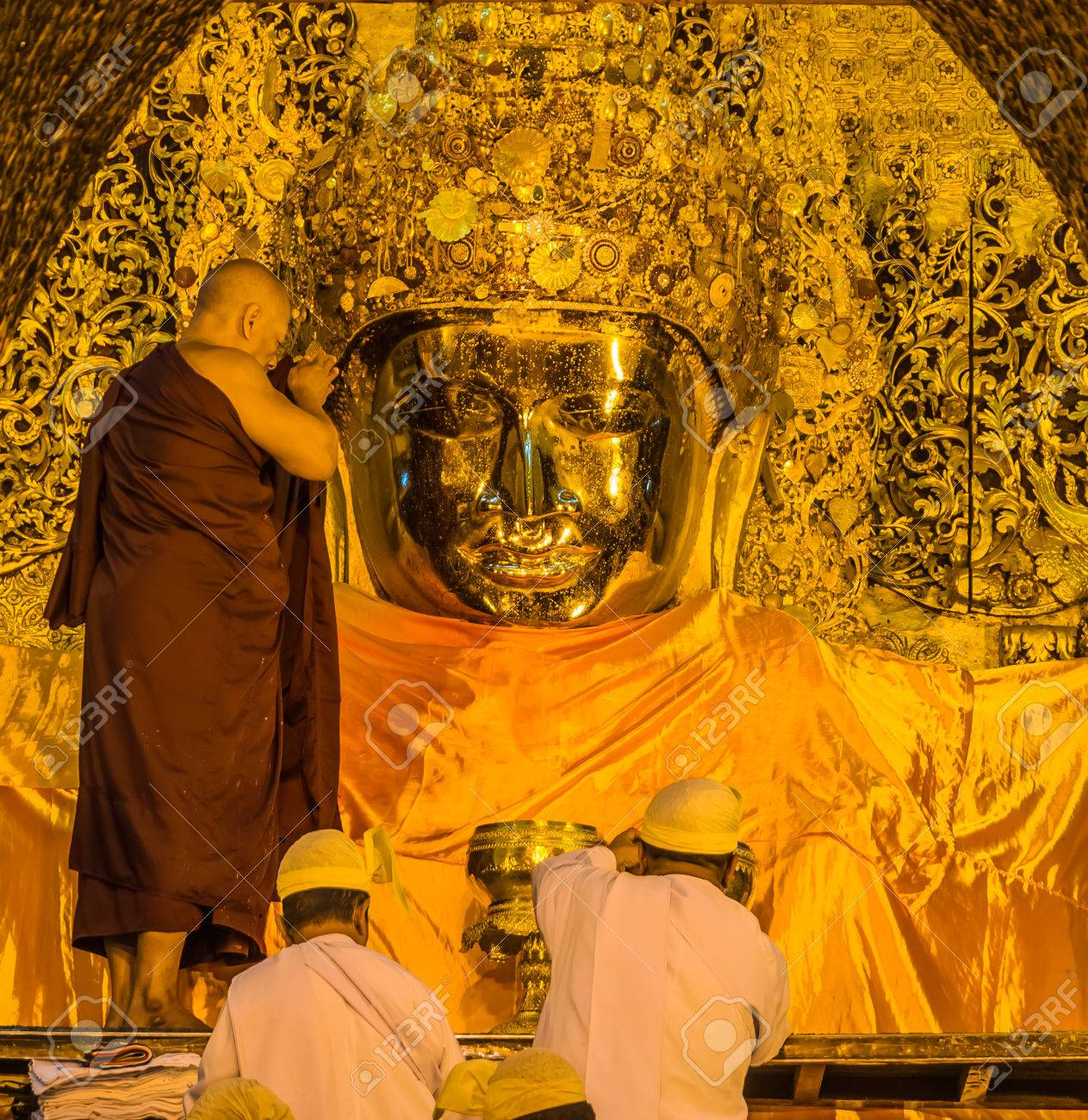 The ritual of daily face washing Mahamuni Buddha in Mandalay, Myanmar Stock Photo - 25655729