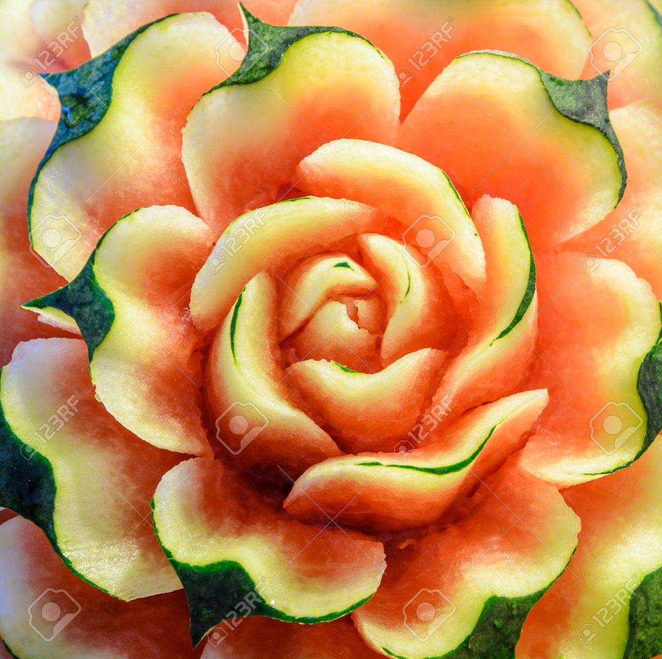 Thai fruit carving of watermelon rose flower stock photo picture