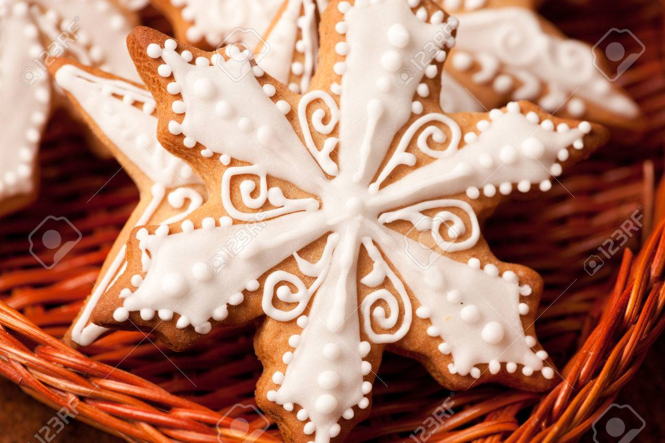 Close Up Gingerbread Snowflakes In Wicker Heart