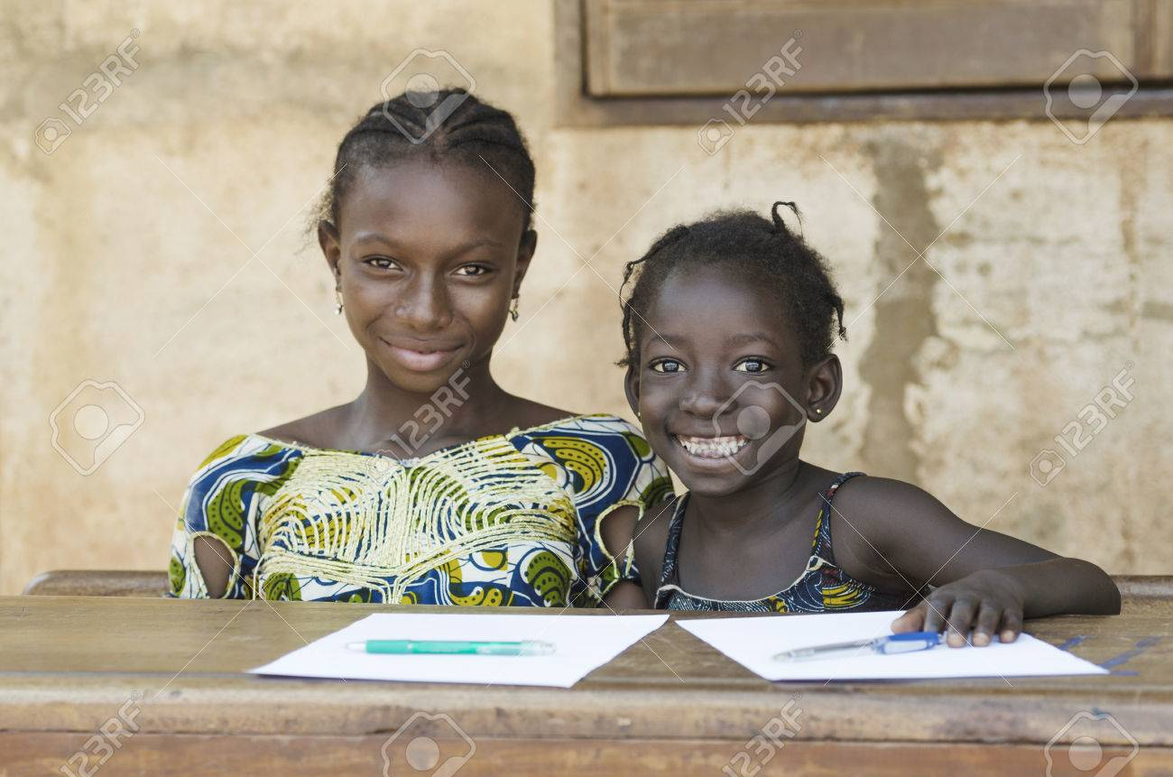 Two African Ethnicity Children Smiling Studying in a School Environment (Schooling Education Symbol) - 69928705