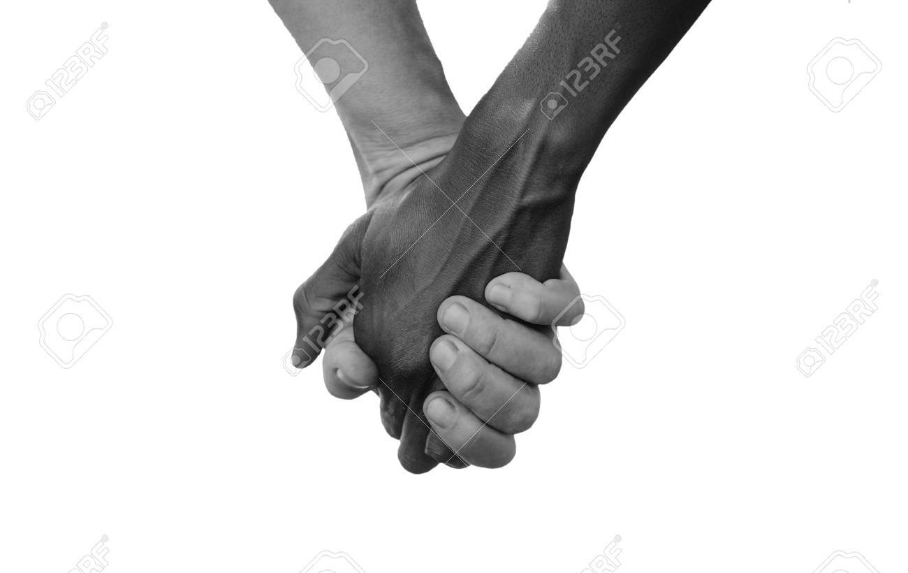 Black and white hold hands for africa union peace love a beautiful shot with lots of possible background symbols no to racism