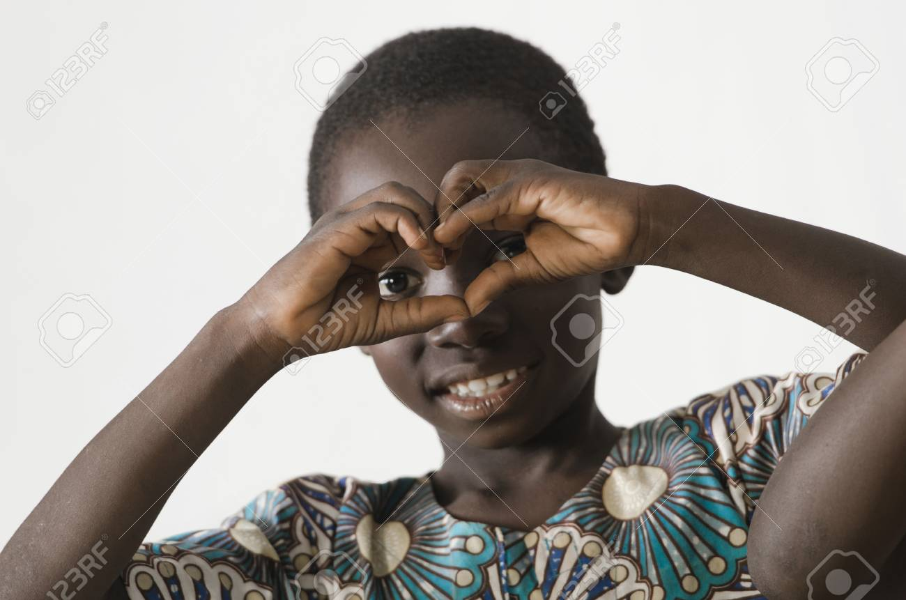 Little african black child showing heart symbol with his hands little african black child showing heart symbol with his hands isolated on white stock photo buycottarizona Images