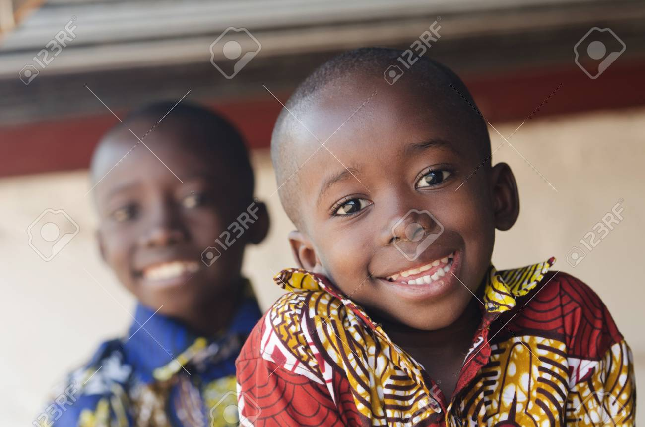 Stock photo two gorgeous african children portrait outdoors smiling and laughing