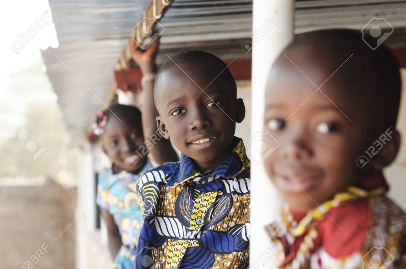 Stock photo three african children smiling and laughing outdoors