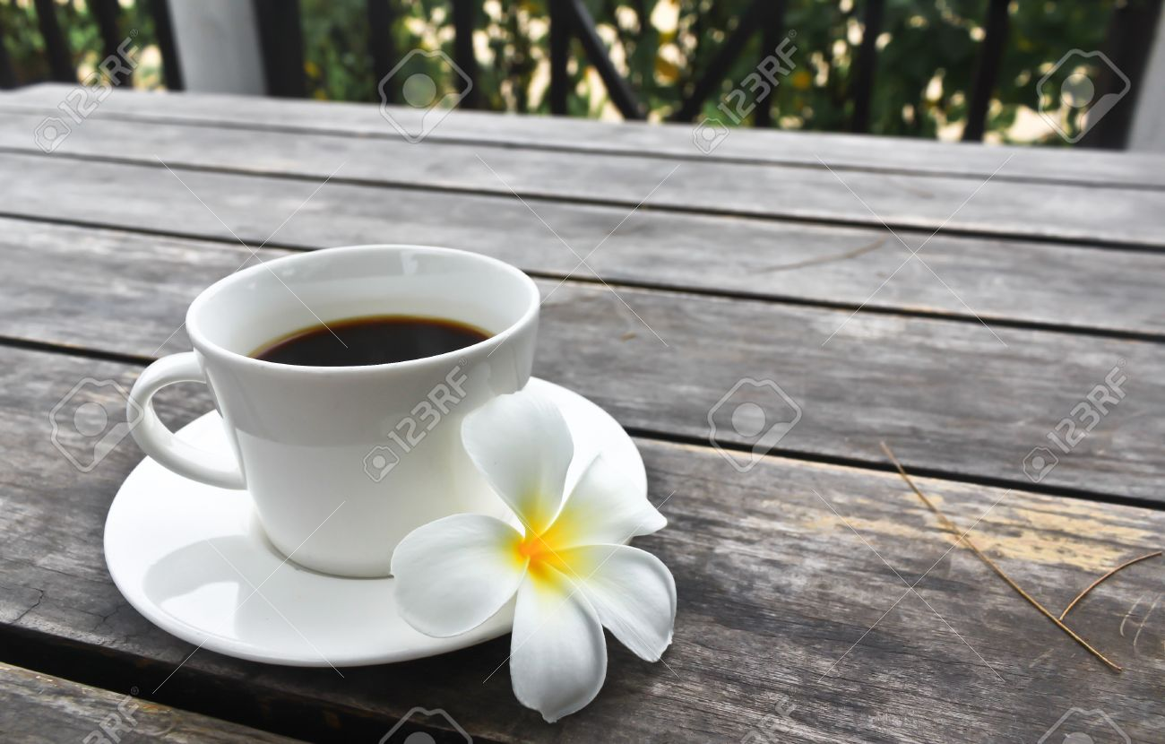 Coffee cup and Frangipani Flower on the wooden table Stock Photo - 14037156