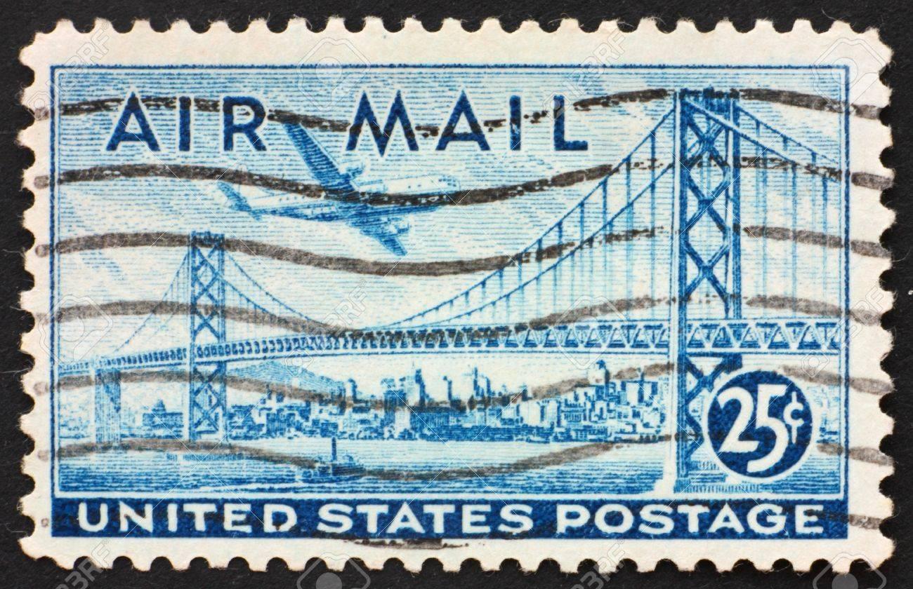 UNITED STATES OF AMERICA - CIRCA 1947: a stamp printed in the United States of America shows plane over San Francisco � Oakland Bay Bridge, circa 1947 Stock Photo - 10495504