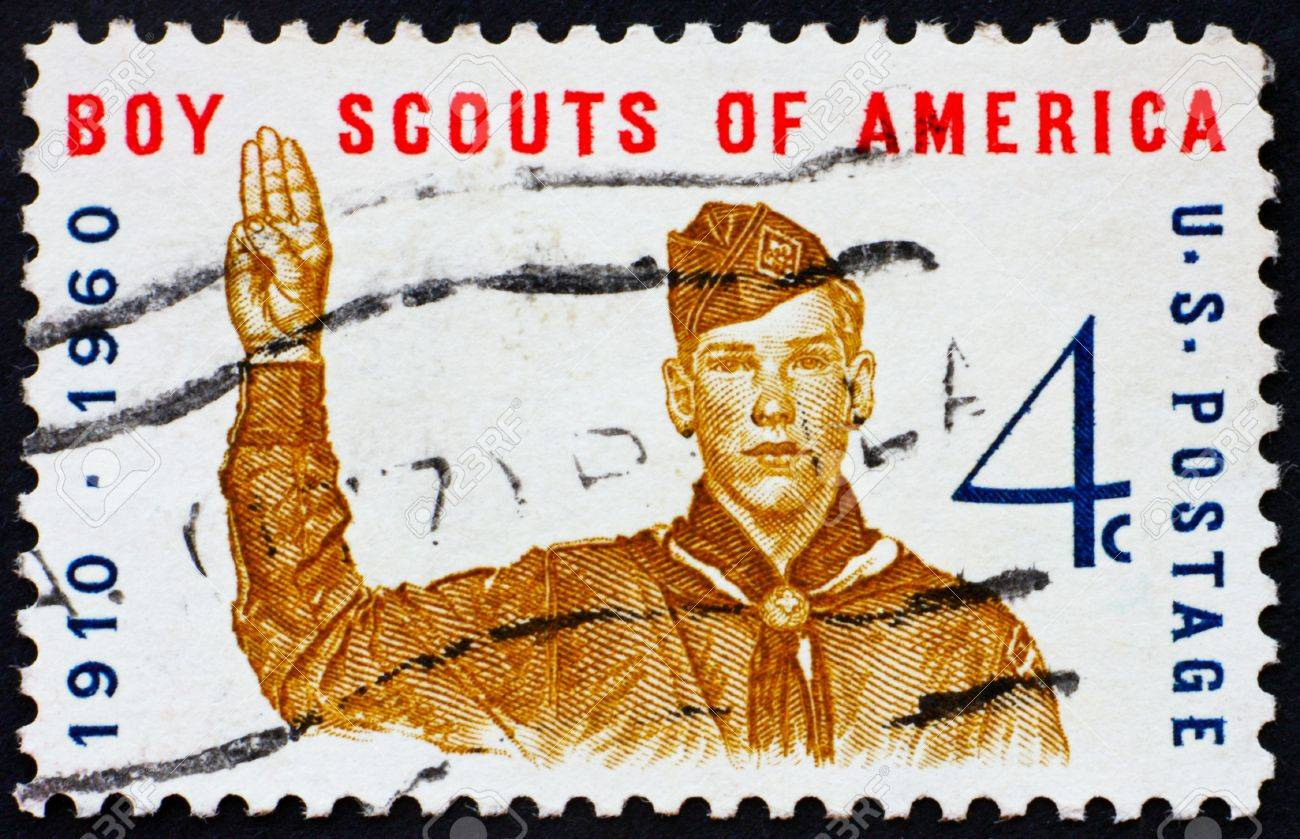 UNITED STATES OF AMERICA - CIRCA 1960: a stamp printed in the United States of America shows Boy scout giving scout sign, 50th anniversary of Boy scouts of America, circa 1960 Stock Photo - 10521075