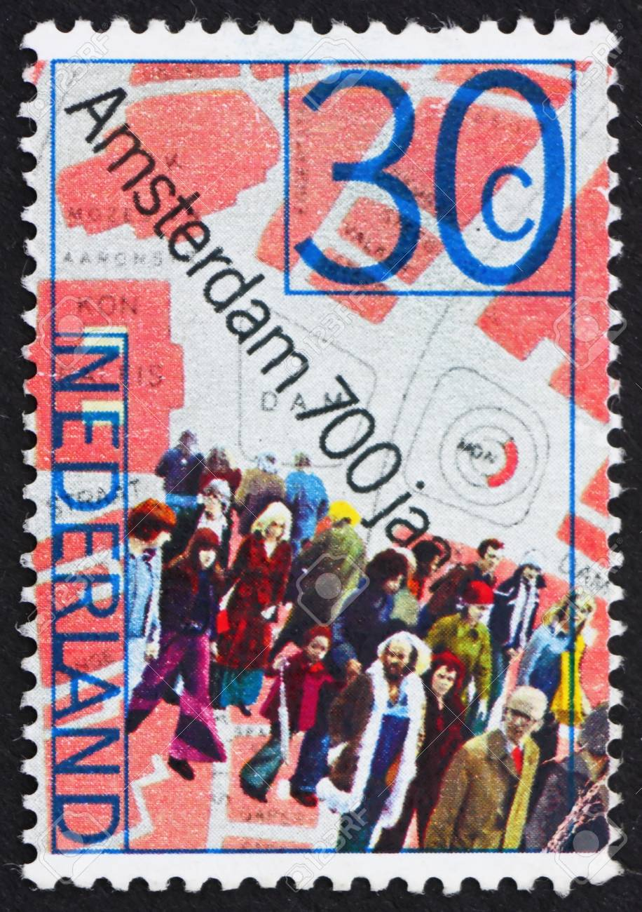 NETHERLANDS - CIRCA 1975: a stamp printed in the Netherlands shows People and Map of Dam Square, 700th anniversary of Amsterdam, circa 1975 Stock Photo - 12059562