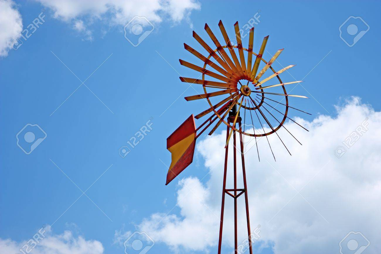 Vintage farm windmill against blue sky Stock Photo - 12503537