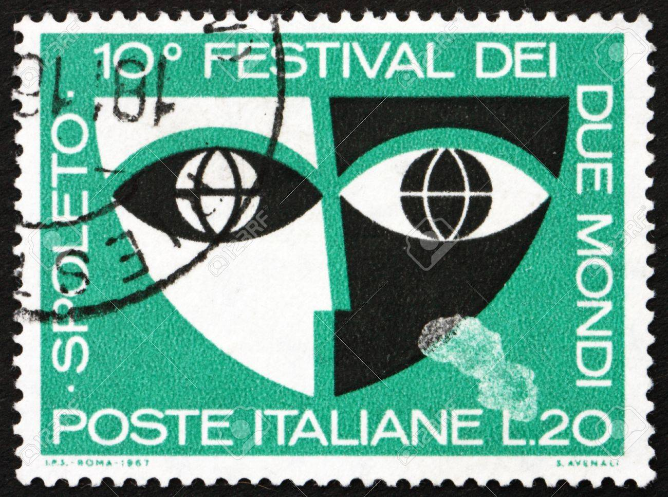 ITALY - CIRCA 1967: a stamp printed in the Italy shows Stylized Mask, 10th Festival of Two Worlds, Spoleto, Italy, circa 1967 Stock Photo - 13626894