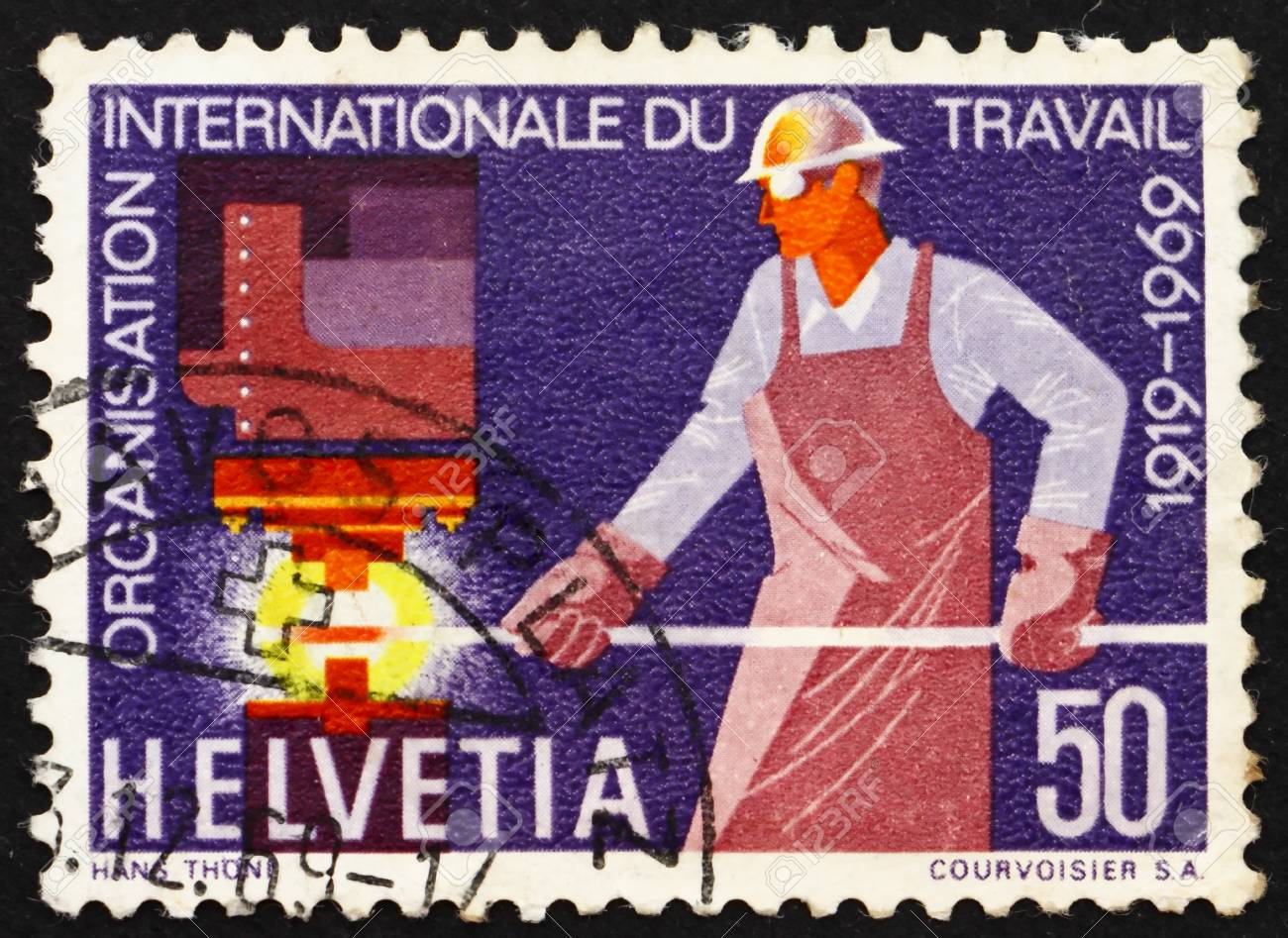 SWITZERLAND - CIRCA 1969: a stamp printed in the Switzerland shows Steelworker, 50th anniversary of the International Labor Organization, circa 1969 Stock Photo - 13685503
