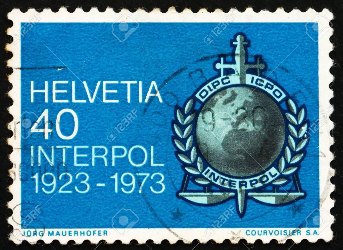 スイス - 1973 年頃: スイス連邦共和国で国際刑事警察機構の紋章は ...