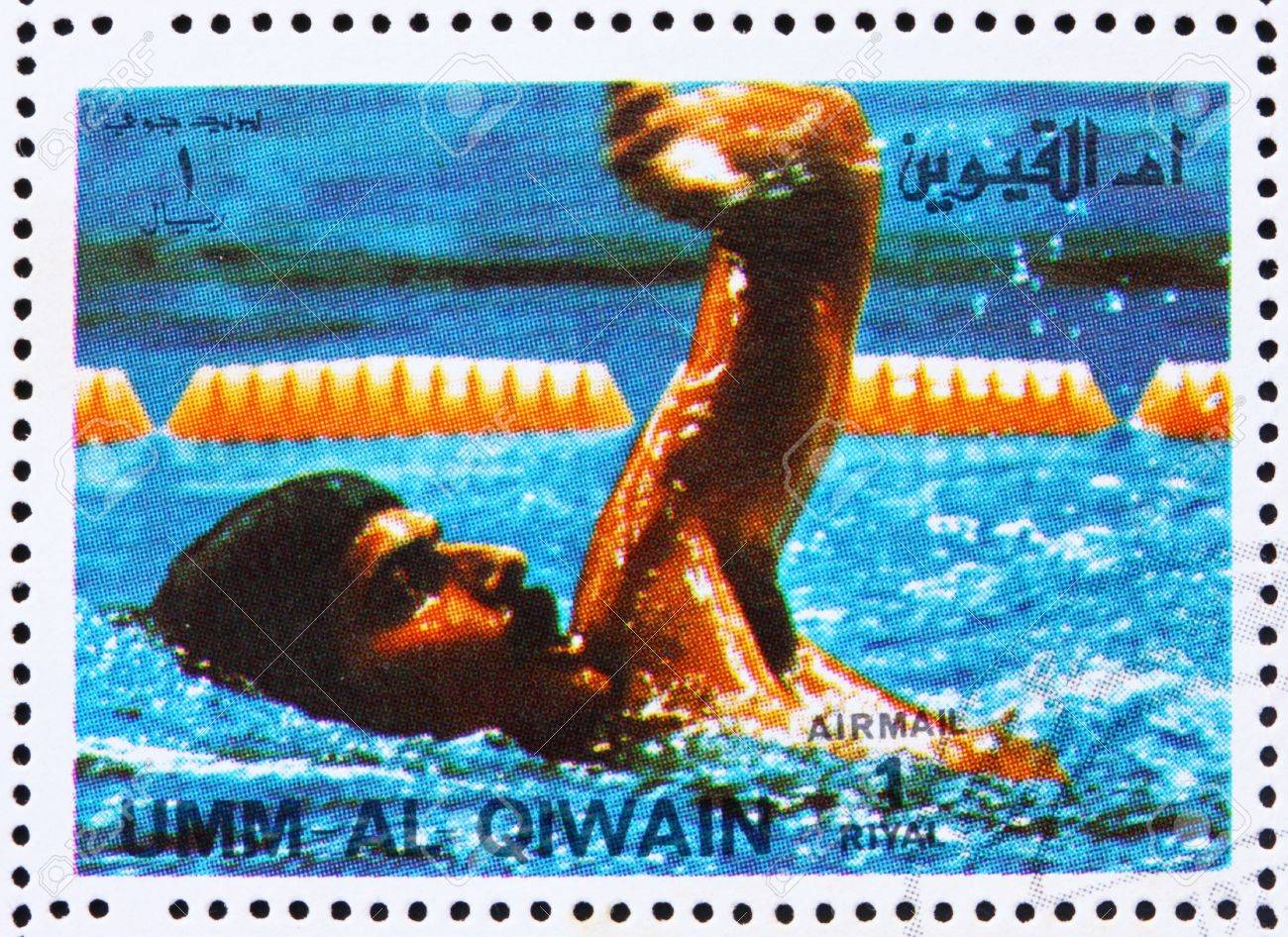 UMM AL-QUWAIN - CIRCA 1972: a stamp printed in the Umm al-Quwain shows Mark Spitz, USA, Winner of the Summer Olympics Munich 1972, circa 1972 Stock Photo - 14146353