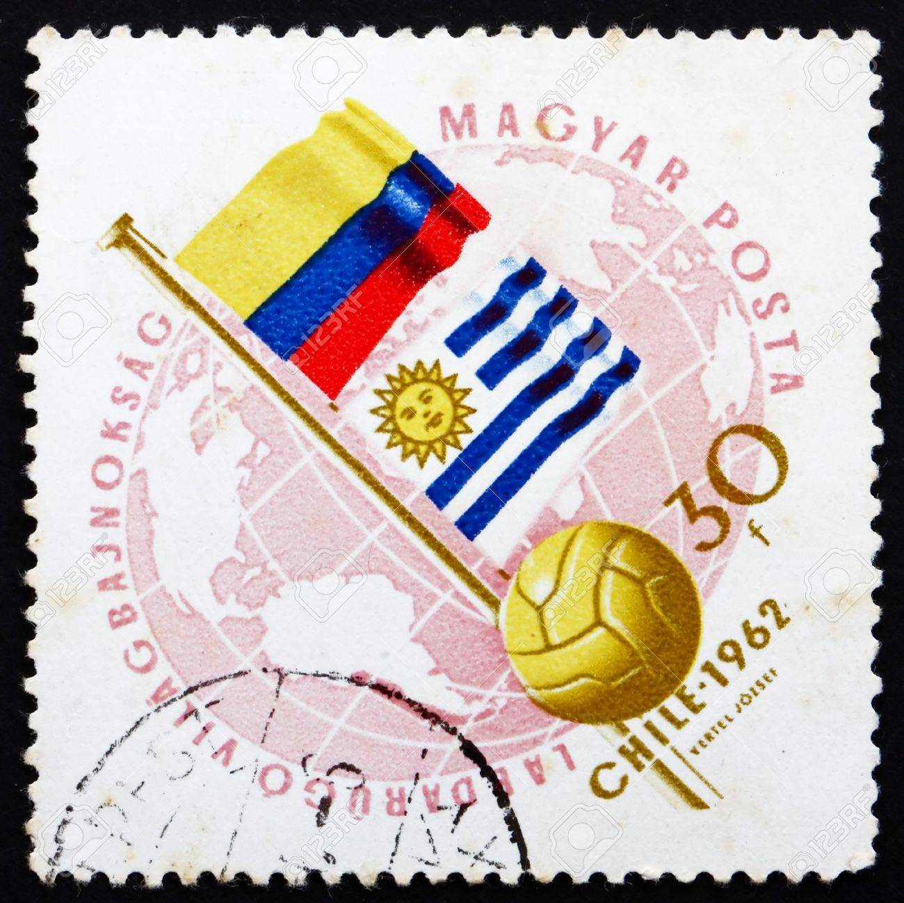 HUNGARY - CIRCA 1962: a stamp printed in the Hungary shows Globe, Ball and Flags of Argentina and Bulgaria, World Cup Soccer Championship, Chile, circa 1962 Stock Photo - 14224088