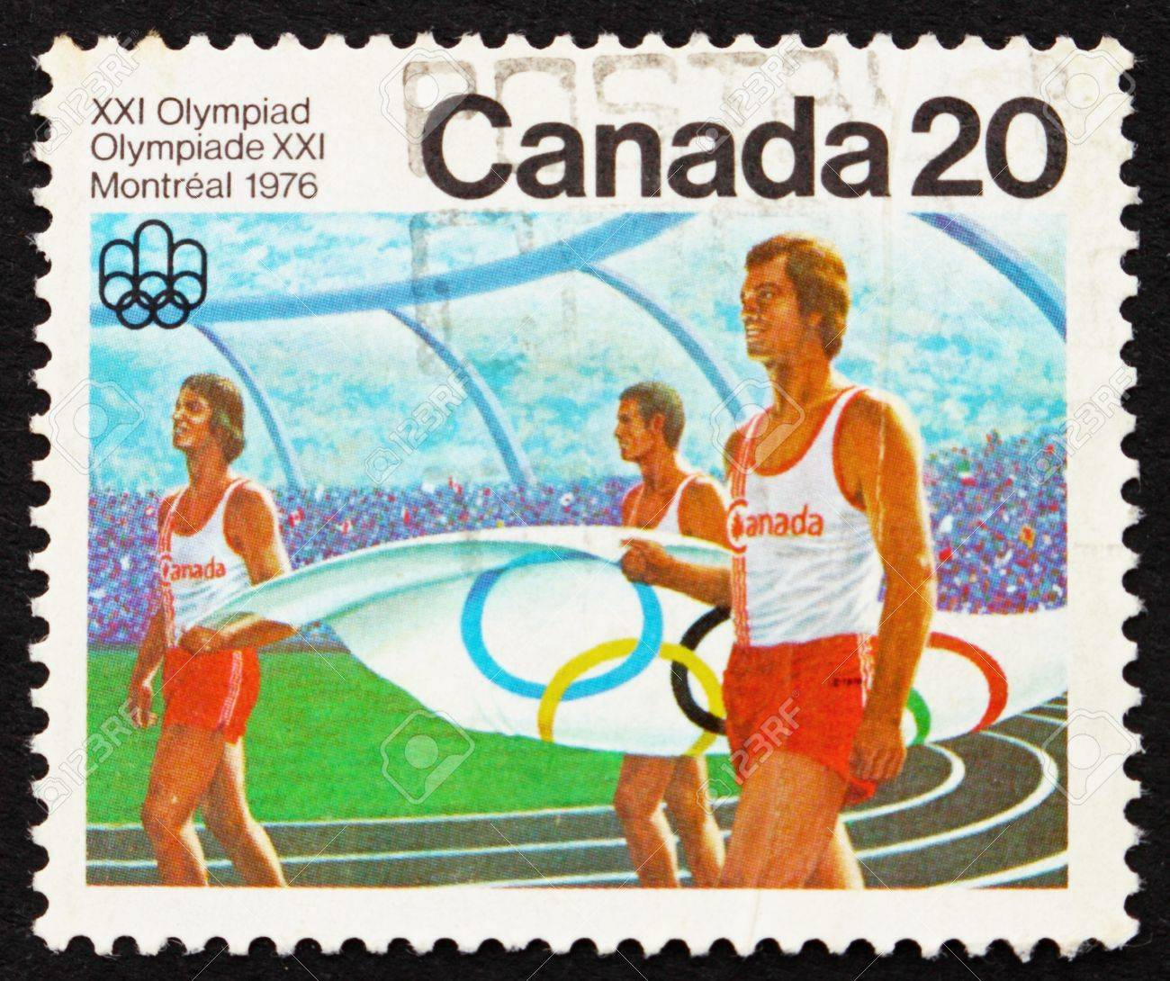 CANADA - CIRCA 1976: a stamp printed in the Canada shows Canadian Athletes carrying Olympic Flag, Montreal 1976, circa 1976 Stock Photo - 15942846
