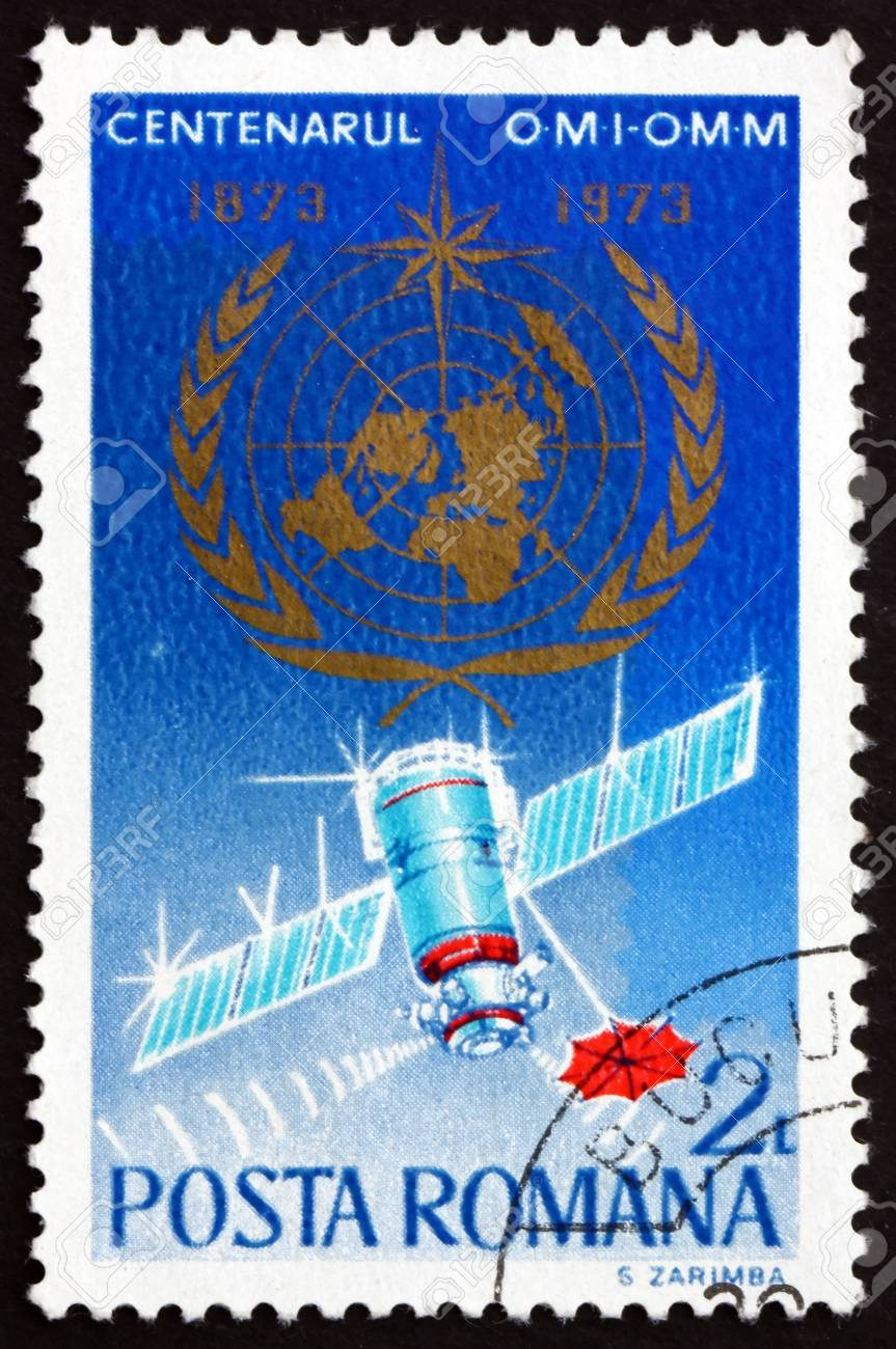 ROMANIA - CIRCA 1973: a stamp printed in the Romania shows WMO Emblem, Weather Satellite, Centenary of International Meteorological Cooperation, circa 1973 Stock Photo - 16979311