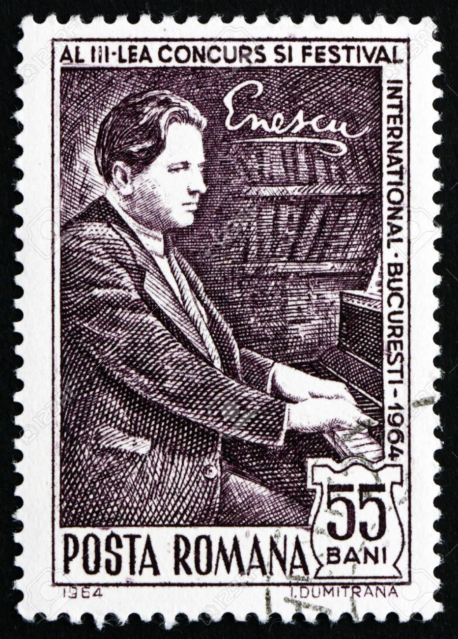 ROMANIA - CIRCA 1964: a stamp printed in the Romania shows George Enescu at Piano, Composer, circa 1964 Stock Photo - 17063410