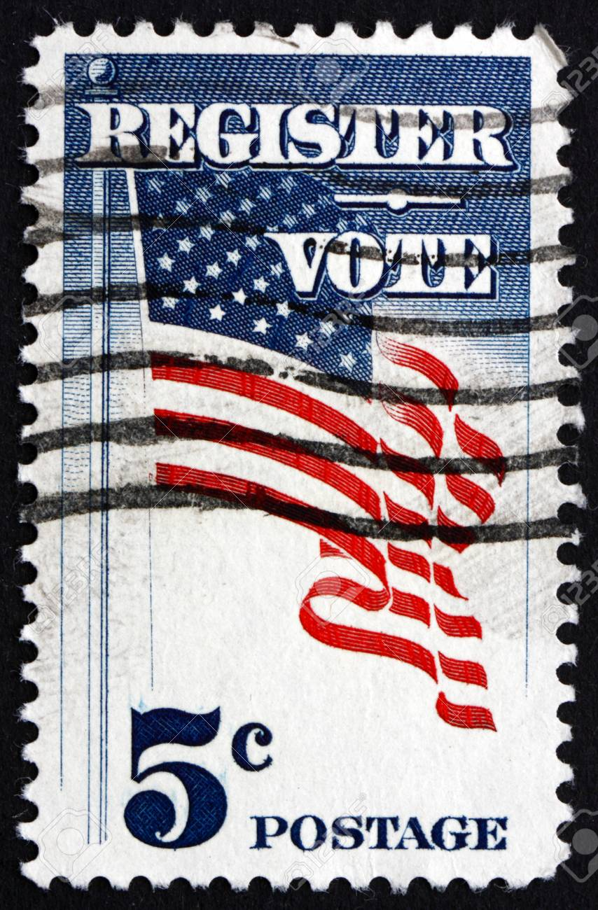 7b40a32ab0d6 UNITED STATES OF AMERICA - CIRCA 1964  a stamp printed in the United States  of America shows US Flag