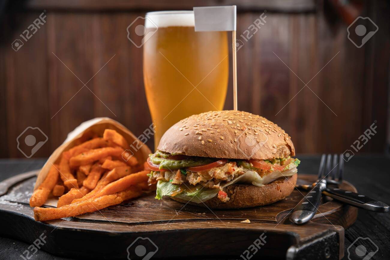 American hamburger with crab and french fries meat on wooden board - 147720527