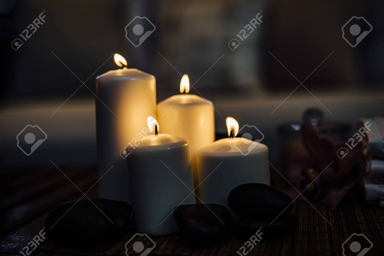 Romantic candle in beautiful dark evening light for events. Luxury events or weddings. Design element. Candles, romance, love, hope, relaxation, - 141969119