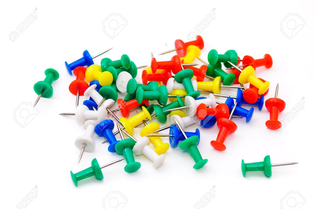 Colored plastic pins. Isolated on white background Stock Photo - 9848396