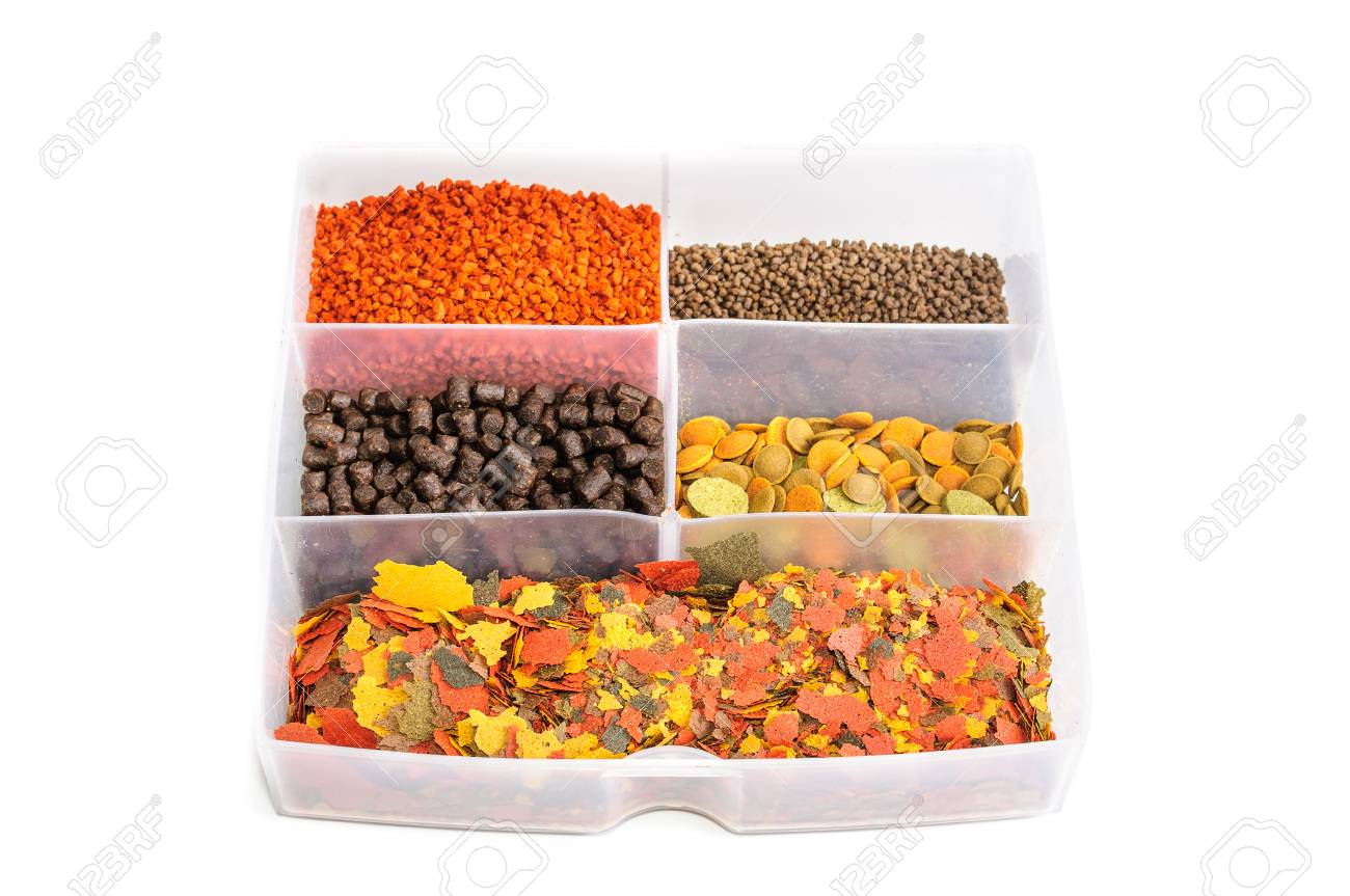 Dry food for aquarium fish  The photo on white background Stock Photo - 14479831