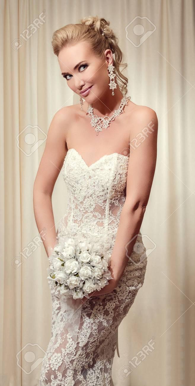 Beautiful Bride In Elegant White Lace Wedding Dress Wearing