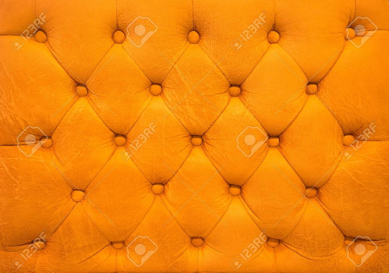 Divano Pelle Arancione : Vintage in pelle arancione tappezzeria divano capitonnè sfondo