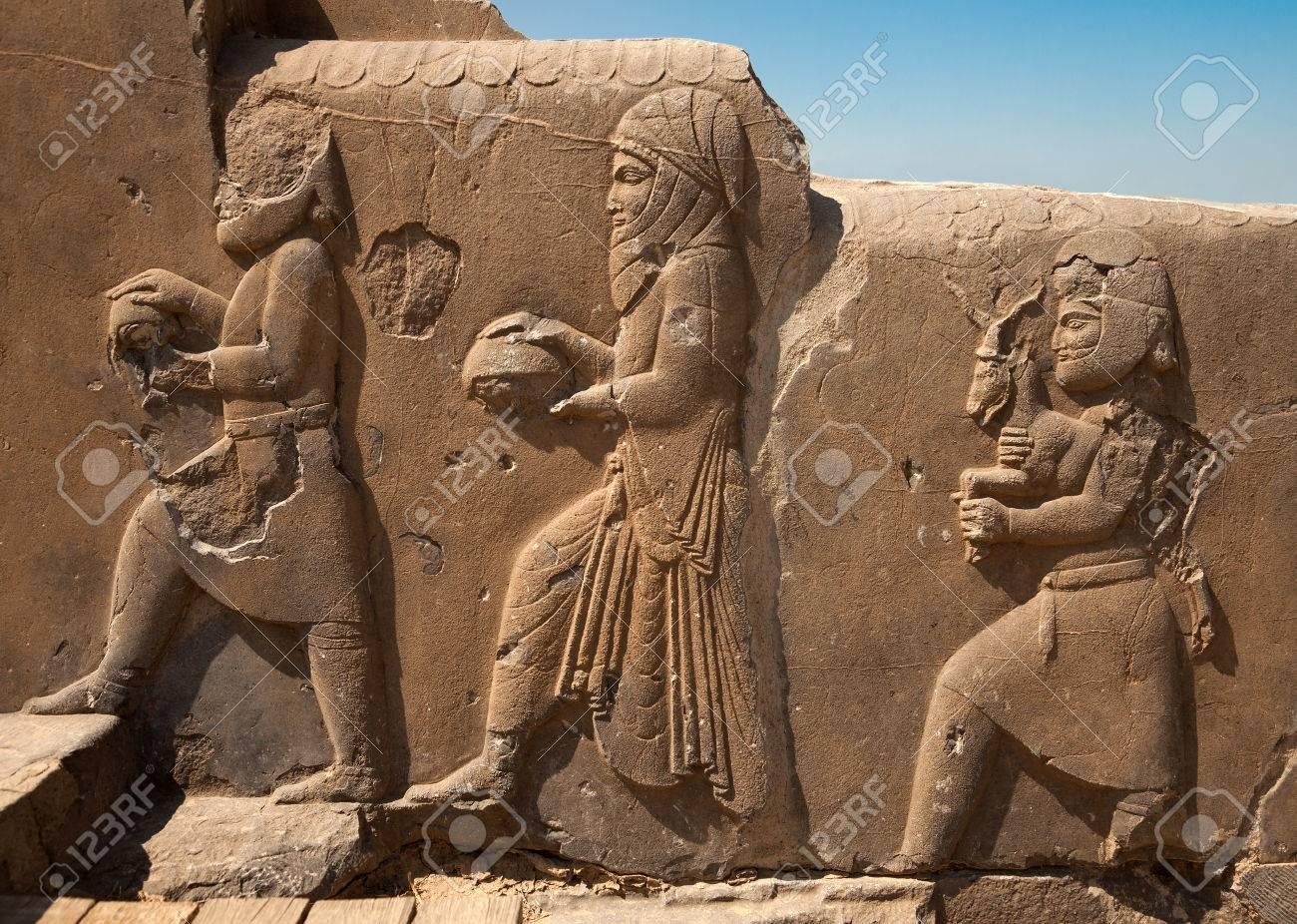 Bas relief carvings of dignitaries and representatives bringing
