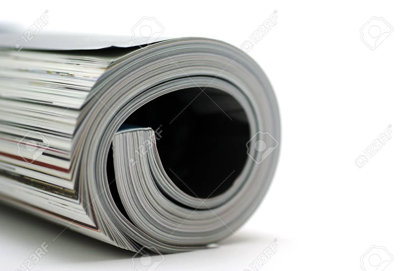 Curled glossy magazine isolated on white background. Stock Photo - 3810633