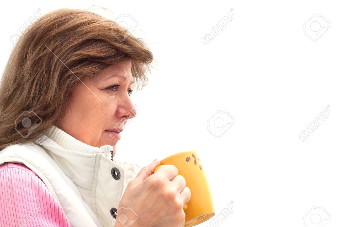 Portret of mature  woman drinking coffee.Isolated on white background Stock Photo - 11936258