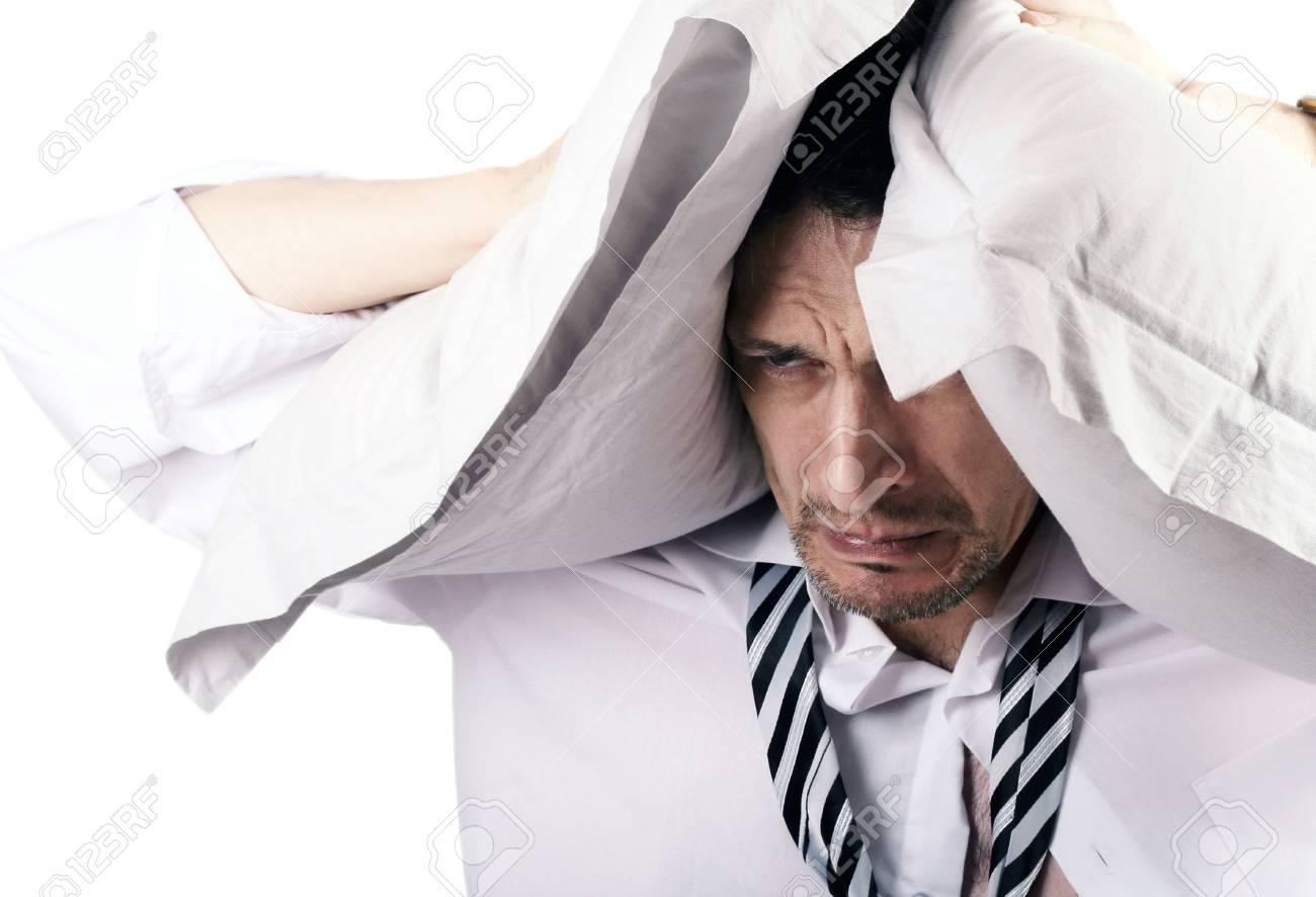 The businessman was closed from problems by pillows Stock Photo - 6191421