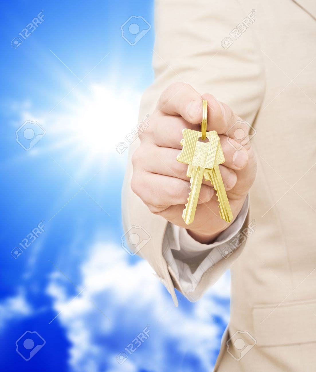 Handing over the keys.Blue skies in the background Stock Photo - 6519128