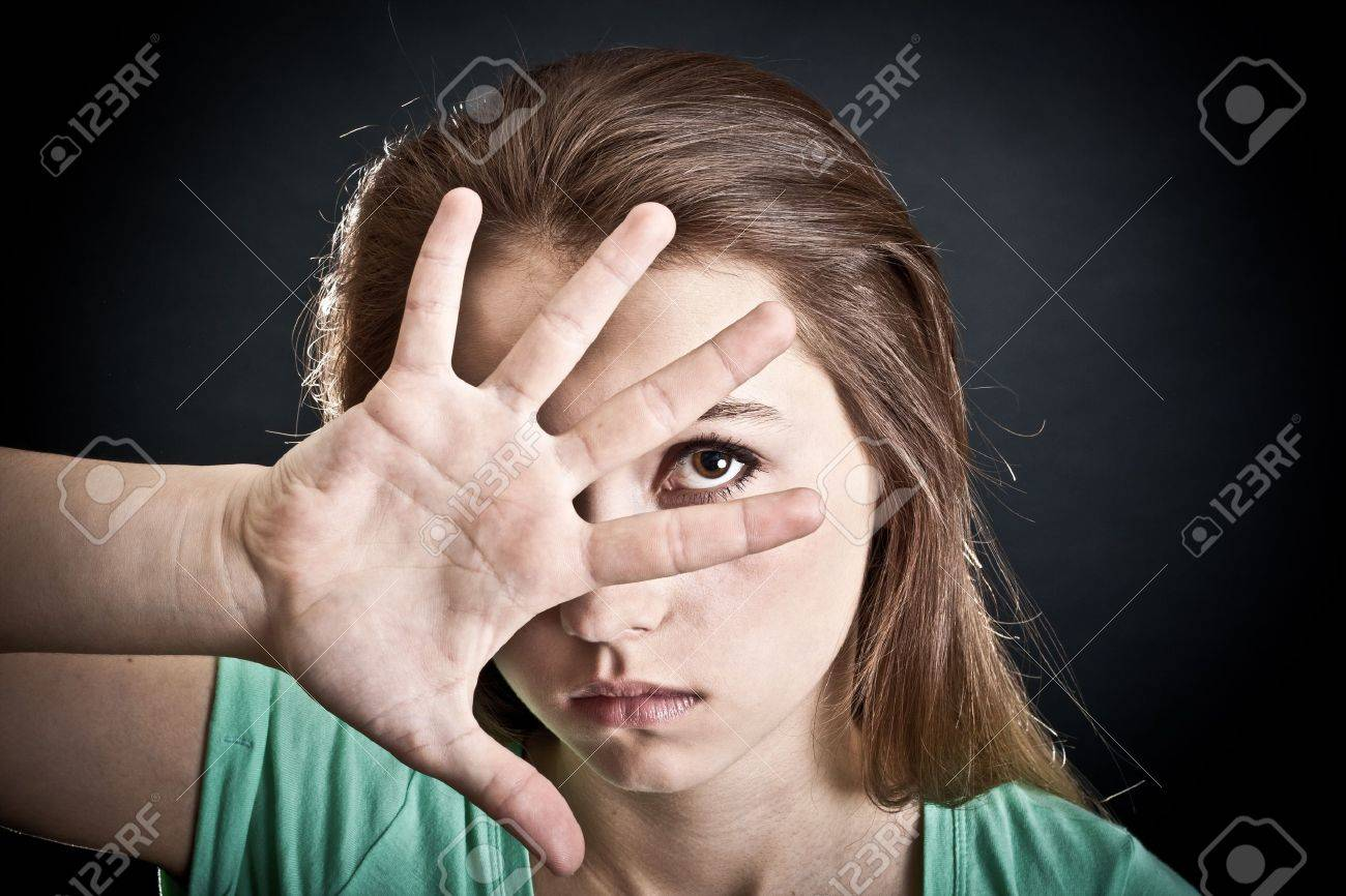 Portrait of the young woman. The person is closed by a hand Stock Photo - 9224392