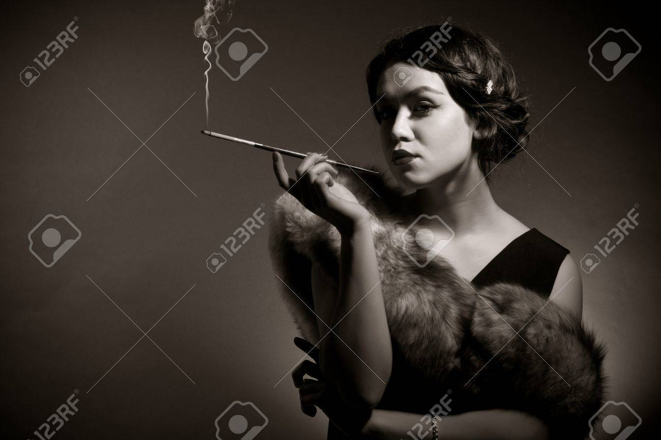 Portrait of the young woman in style of a retro against a dark background Stock Photo - 10413584