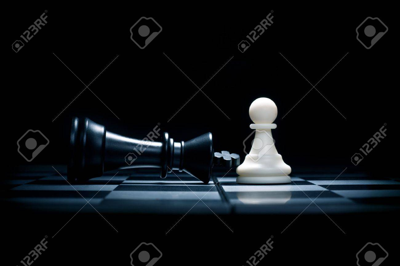 Chessmen. A pawn and the won king Stock Photo - 10620532