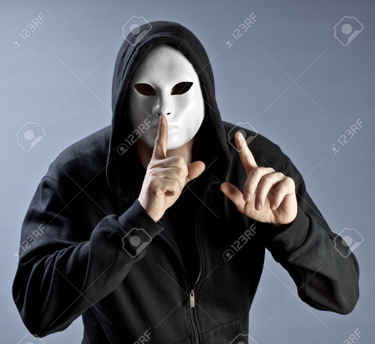 The person in a mask calls for silence Stock Photo - 12384667