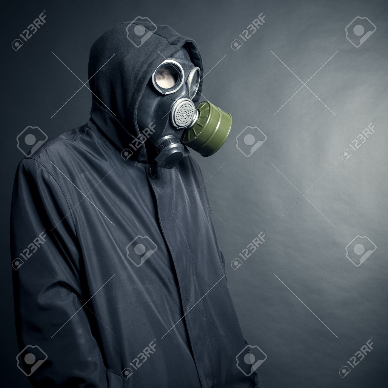A man in a gas mask on a black background Stock Photo - 15912465