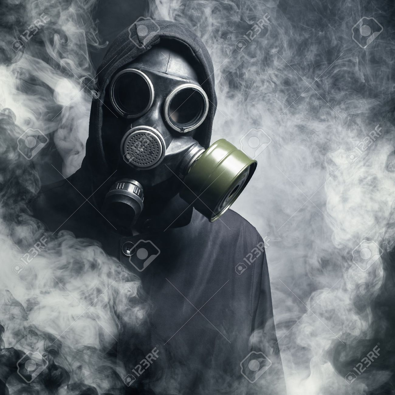 a man in a gas mask in the smoke black background stock photo