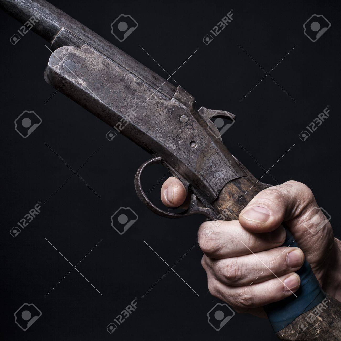 man holds in his hand an old shotgun.Black background Stock Photo - 17955063
