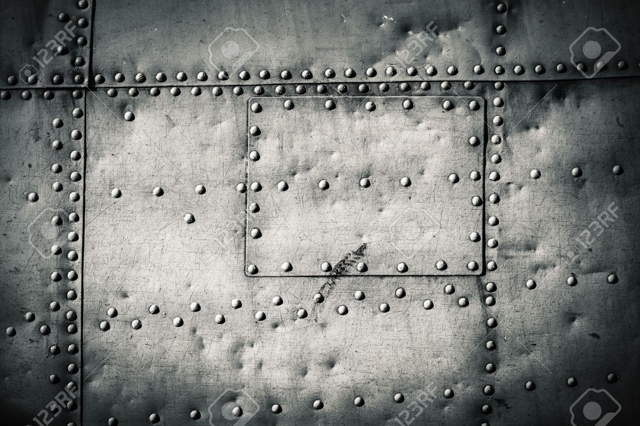 rivets on a metal plate - 46574308