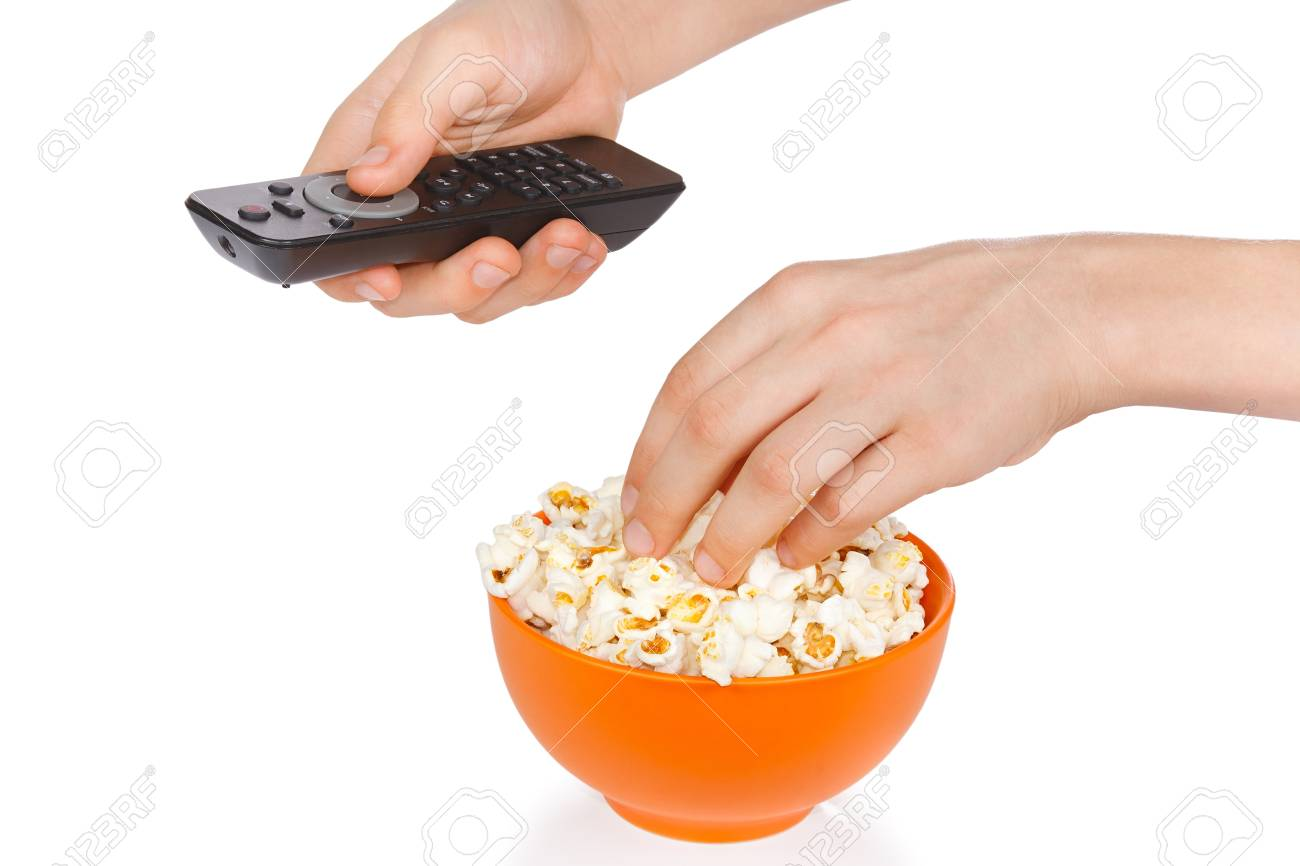 Hands a teenager with popcorn and remote control on a white background Stock Photo - 12032883