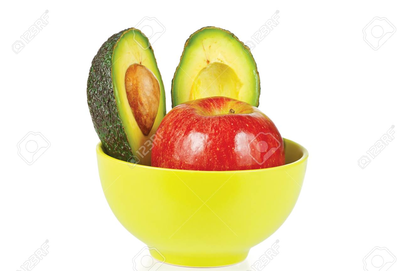 Sliced fresh avocado and apple in ceramic cup on a white background Stock Photo - 12154784
